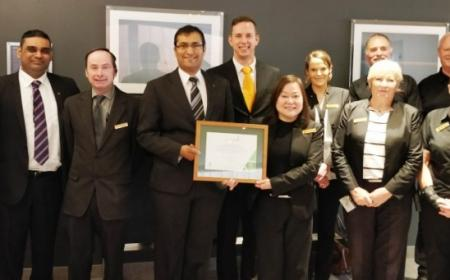 Sudima Christchurch Airport team receiving CarboNZero certification.